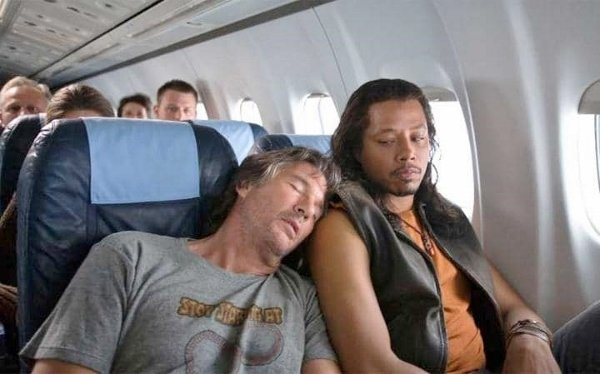 celebrity sleeping on plane