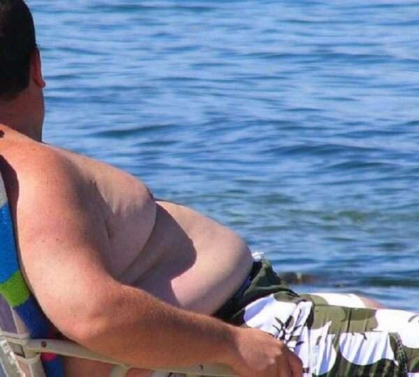 Overweight Man on Beach