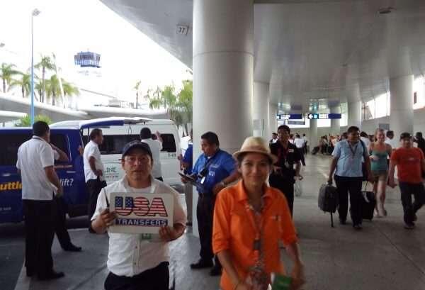 Usa Transfers Cancun Representative Waiting At Arrivals