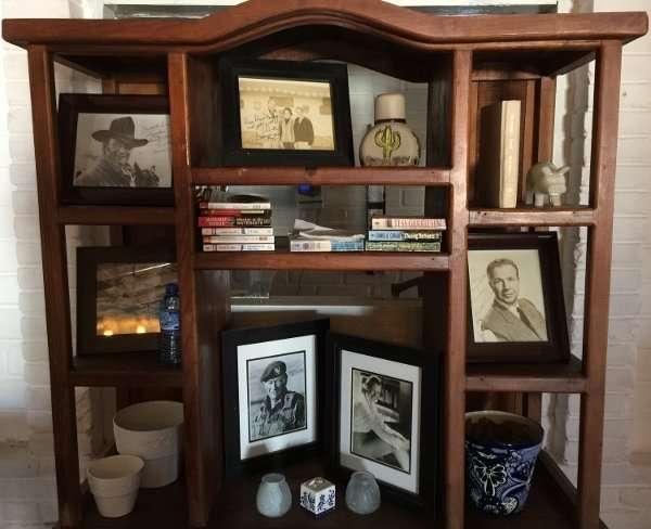 Hotel Serenidad Bookcase with John Wayne Photo
